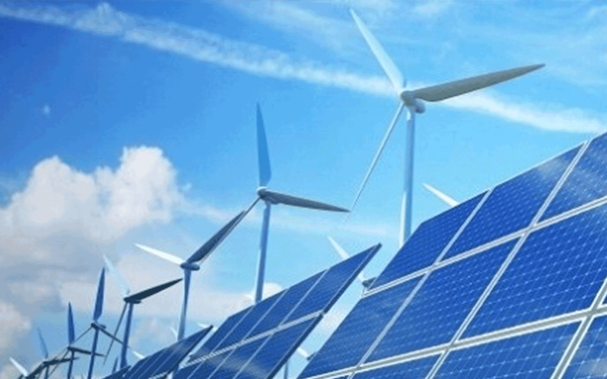 Photo of windmills over solar panels